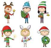 Weihnachtskinder mit Geschenken Stockfoto