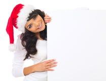 Weihnachtsküken mit Vorstand Stockfotografie