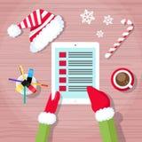 Weihnachtskontrollgeschenk-Wunschliste Weihnachtsmann Stockfoto