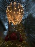 Weihnachtskugel mit Lichtern Stockbilder