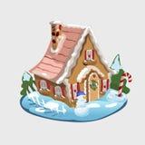 Weihnachtslebkuchenhaus und -dekorationen herum Lizenzfreie Stockbilder