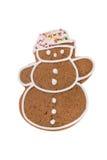 Weihnachtslebkuchenschneemann lokalisiert auf einem weißen Hintergrund Lizenzfreie Stockfotos