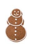 Weihnachtslebkuchenschneemann lokalisiert auf einem weißen Hintergrund Lizenzfreie Stockbilder