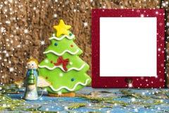 Weihnachtsleerer Fotorahmenengel und -baum Stockfotos