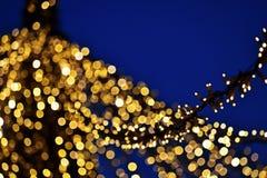 Weihnachtslichter am Abend stockbild