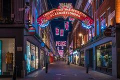 Weihnachtslichter auf Carnaby-Straße, London Großbritannien Stockfotografie