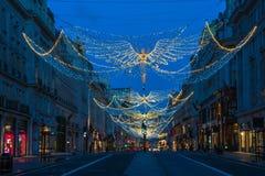 Weihnachtslichter auf Regent Street, London Großbritannien Lizenzfreie Stockfotos