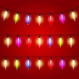 Weihnachtslichter - elektrische Birnen aufgereiht Stockfoto