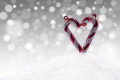 Weihnachtsliebe auf defocused Leuchtehintergrund Stockfotos