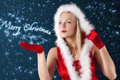 Weihnachtsmädchen, das durchbrennt von der Hand? Stockfotos