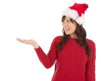 Weihnachtsmädchen, das leere Palme zeigt Stockbild
