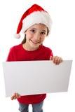 Weihnachtsmädchen, das mit leerem freiem Raum steht Stockfotos