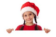 Weihnachtsmädchen, das mit leerem Leerzeichen steht Stockfotos