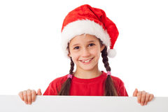 Weihnachtsmädchen, das mit leerer Fahne steht Stockfotografie