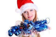 Weihnachtsmädchen im Sankt-Hut Lizenzfreie Stockfotografie