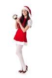 Weihnachtsmädchen mit Alarmuhr. Lizenzfreies Stockfoto