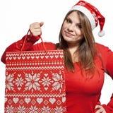Weihnachtsmädchen mit Beutel Stockfoto