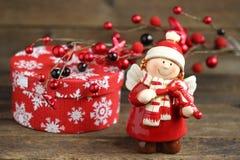 Weihnachtsmädchen mit einer Violine Stockbilder