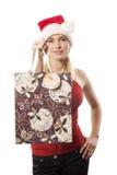 Weihnachtsmädchen mit Einkaufstasche Stockfoto