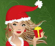 Weihnachtsmädchen mit Geschenk Lizenzfreies Stockbild