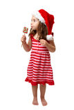 Weihnachtsmädchen mit Süßigkeit stockfotos
