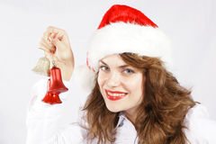 Weihnachtsmädchen mit Verzierungen lizenzfreies stockbild