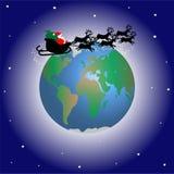 Weihnachtsmann über der Welt Stockbilder