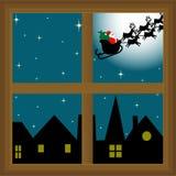Weihnachtsmann-Abflussrinne das Fenster Stockfotografie