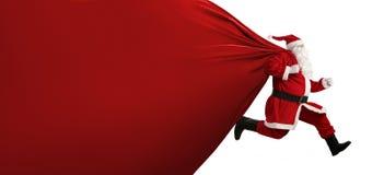 Weihnachtsmann auf dem Lack-Läufer Stockbilder