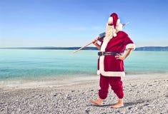 Weihnachtsmann auf dem Strand Stockfotos