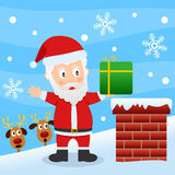 Weihnachtsmann auf einem Dach Stockbild