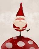 Weihnachtsmann auf Pilz Lizenzfreies Stockbild