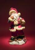 Weihnachtsmann auf rotem Hintergrund Lizenzfreie Stockfotografie