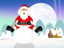 Weihnachtsmann auf Schneeball Stockfoto