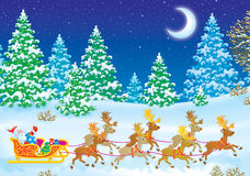 Weihnachtsmann auf seinem Pferdeschlitten mit Renen Lizenzfreie Stockfotos