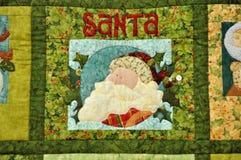 Weihnachtsmann-Bild auf Tuchdekoration Stockbilder