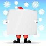 Weihnachtsmann, der ein Blatt Papier anhält Stockfotografie