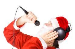 Weihnachtsmann, der ein Lied singt Stockbild
