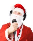 Weihnachtsmann, der ein Lied singt Stockfoto