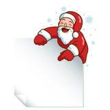 Weihnachtsmann, der ein unbelegtes Zeichen anhält Lizenzfreies Stockfoto