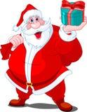 Weihnachtsmann, der Geschenk gibt Stockfoto