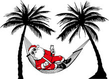 Weihnachtsmann in der Hängematte Lizenzfreie Stockfotos