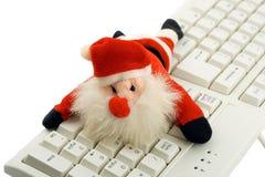 Weihnachtsmann in der Tastatur Stockfotos