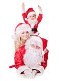 Weihnachtsmann-Familie mit Kind. Stockfotos