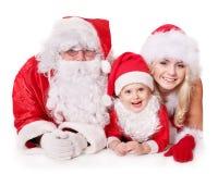 Weihnachtsmann-Familie mit Kind. Stockbilder