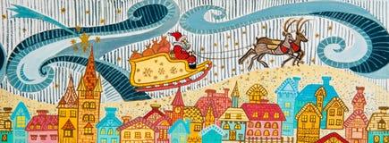 Weihnachtsmann fliyng mit Ren. Stockfotos