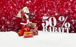 Weihnachtsmann - frohe Weihnachten 50-Prozent-Rabatt Stockbild