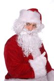 Weihnachtsmann gibt Daumen auf Stockbild