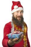 Weihnachtsmann gibt ein Geschenk stockfoto