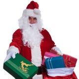 Weihnachtsmann gibt Ihnen Geschenke von der Tasche Lizenzfreie Stockbilder